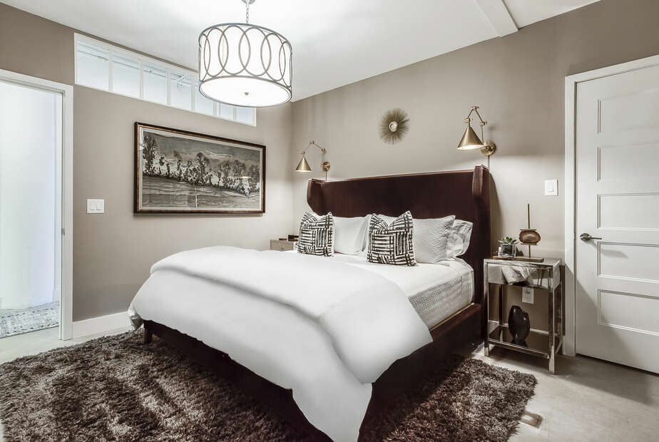 Master Bedroom with Shag Rug and Large Bed at Sherwood Loft