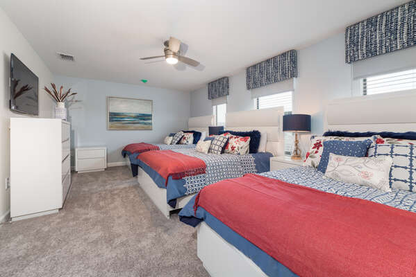 This beautiful and spacious bedroom features three plush Queen sized beds