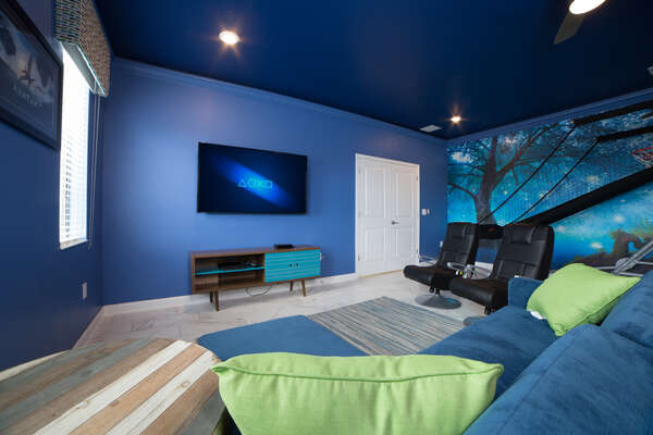 Relax and watch a favorite show in this fun game room