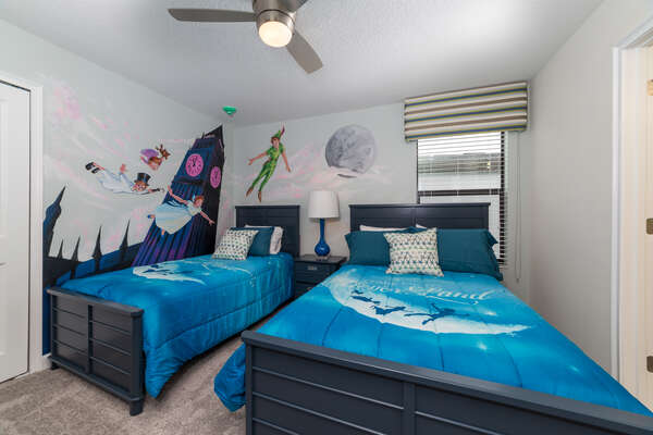 Dream of Neverland in this gorgeous bedroom with custom wall art and a full and twin bed