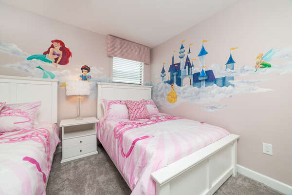 A full and twin bed in this pretty pink room