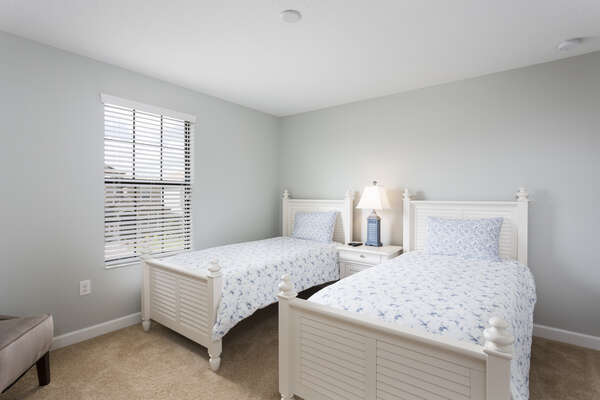 The older children can enjoy their own bedroom with twin beds