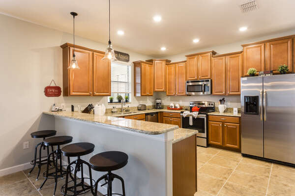 Spacious kitchen with breakfast bar seating for 4