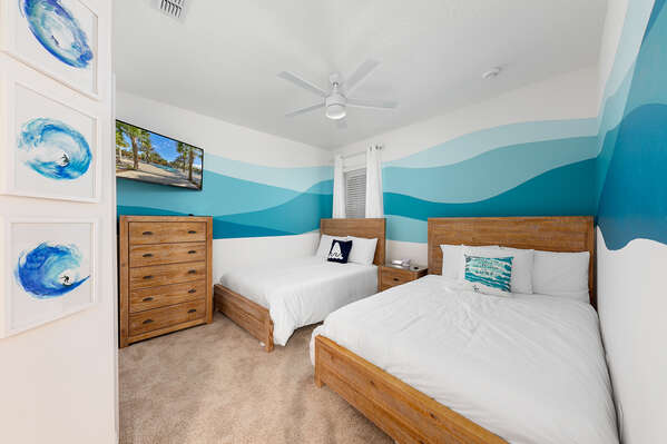 This beach inspired room has two full beds
