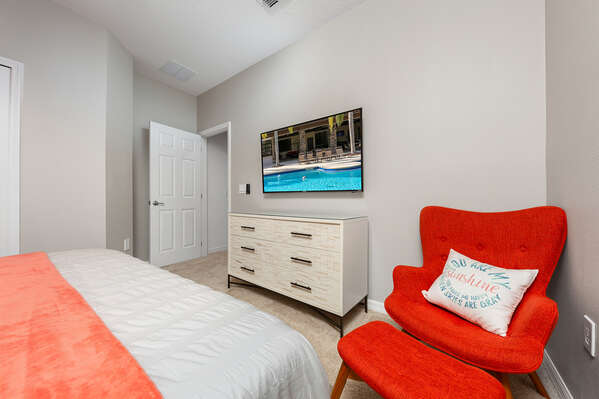 Comfortable bed, chair and TV