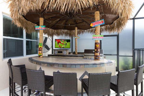 Tiki bar with BBQ grill, TV, and fridge