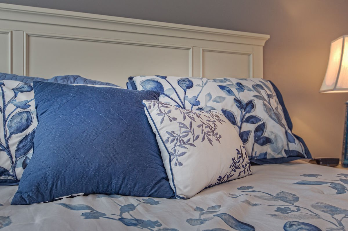 Blue Patterned Pillows on the Queen Bed in the Guest Bedroom