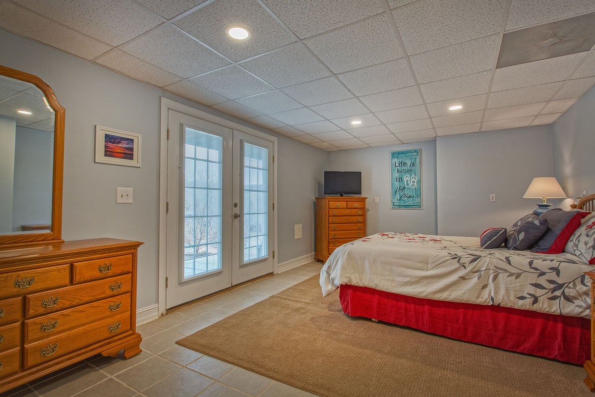 Spacious Queen Bedroom with Doors to Exterior