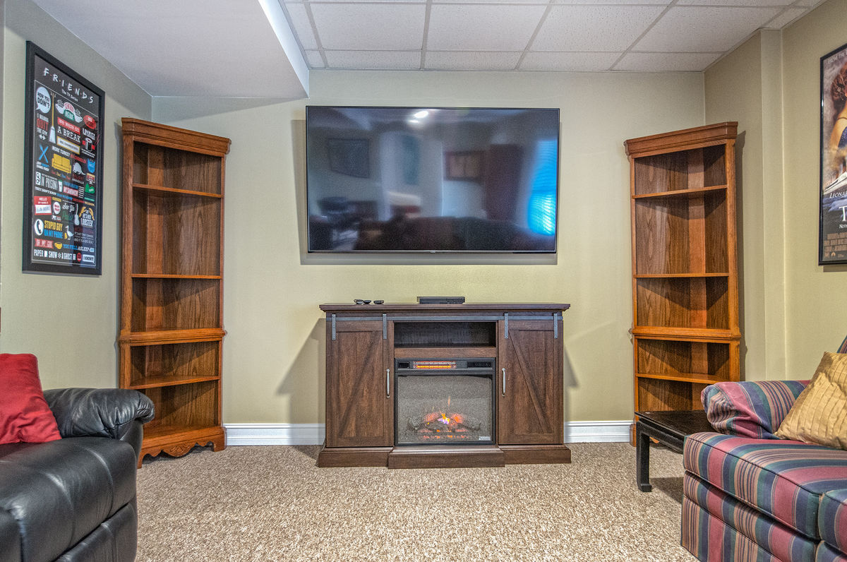 Large Flat Screen TV Mounted in the Lower Level Family Room