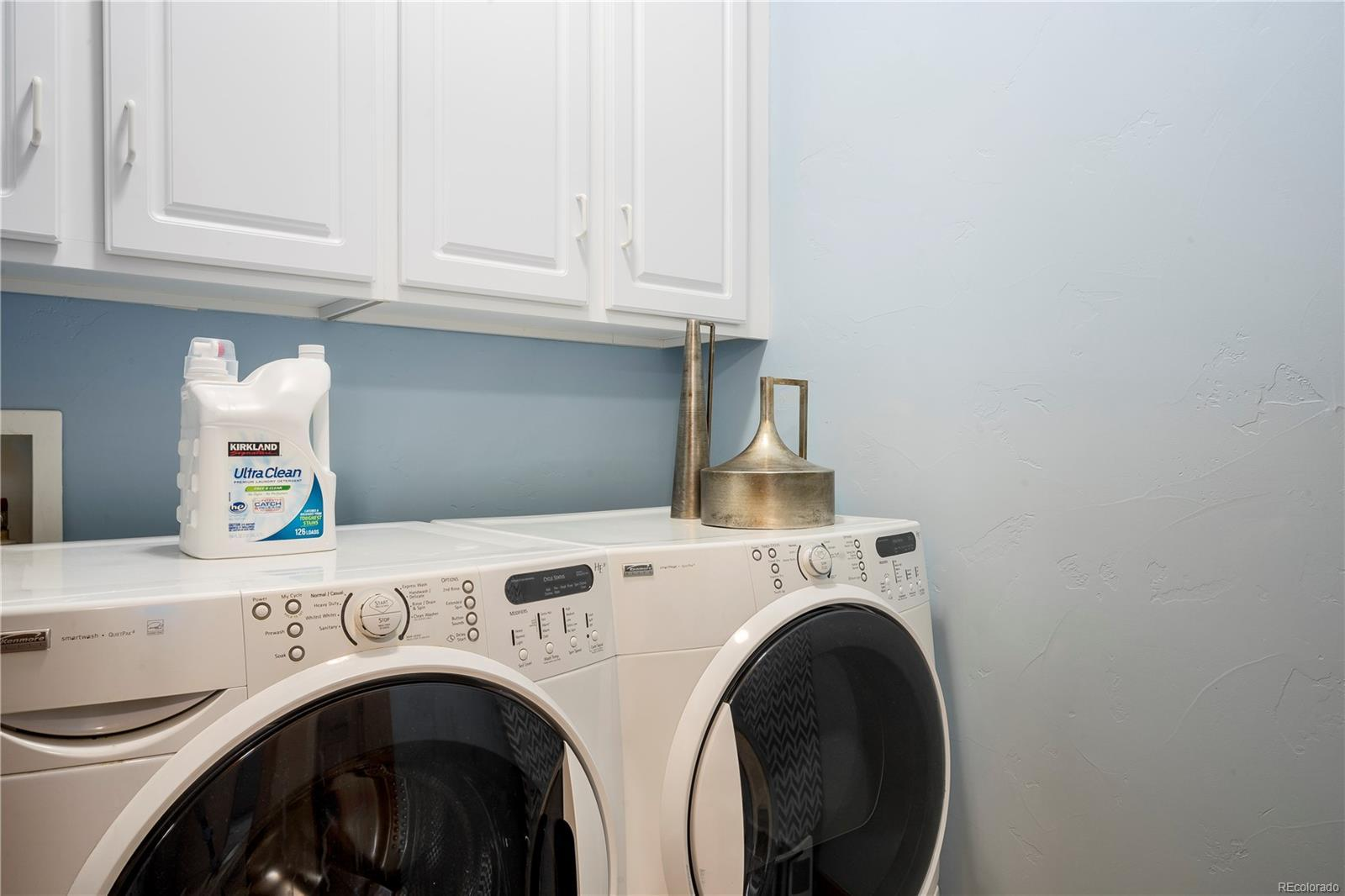 Laundry Room with Washer, Dryer, and Wall Cabinets.