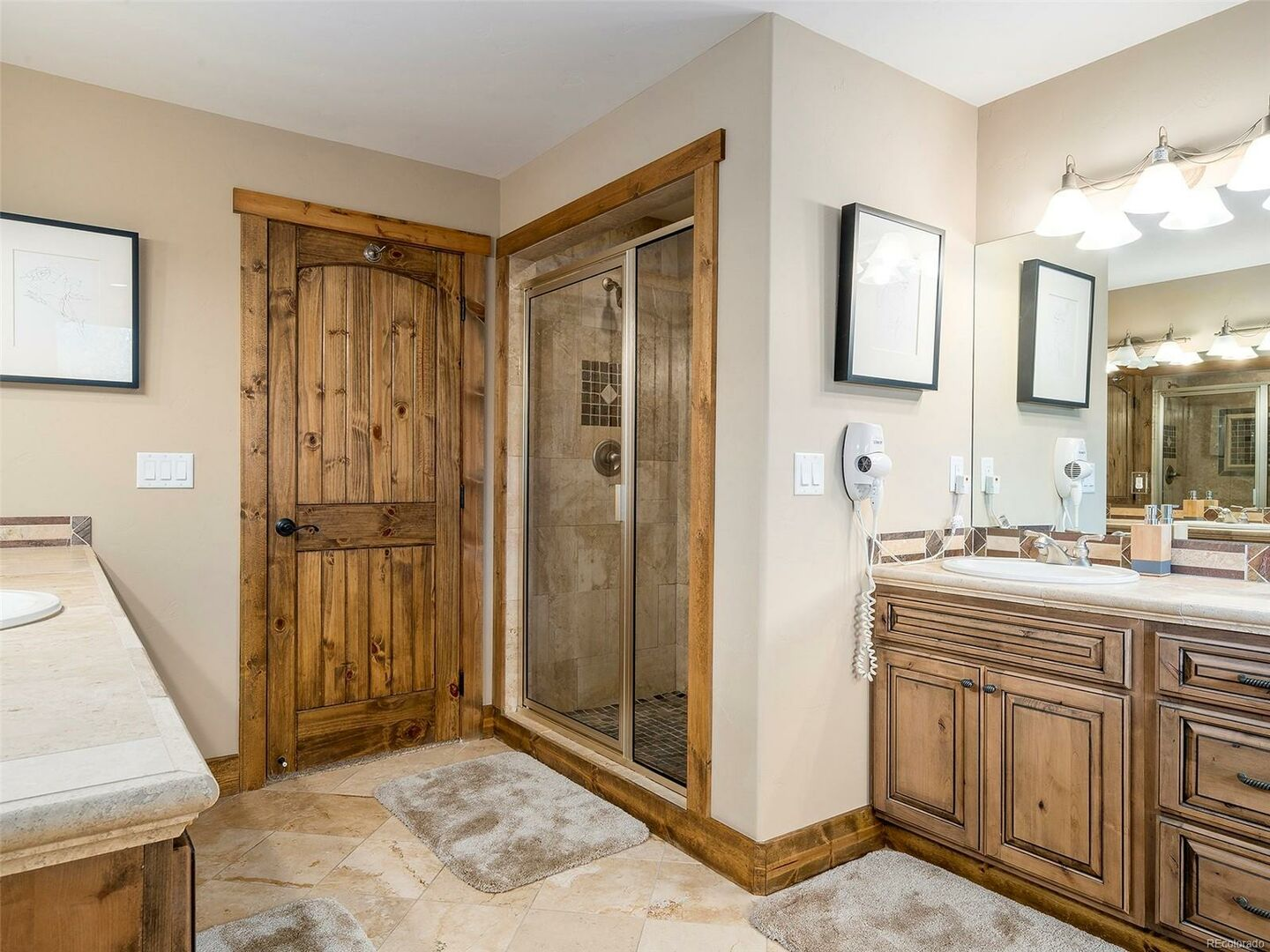 Walk-In Shower, Two Vanities, and Mirrors.