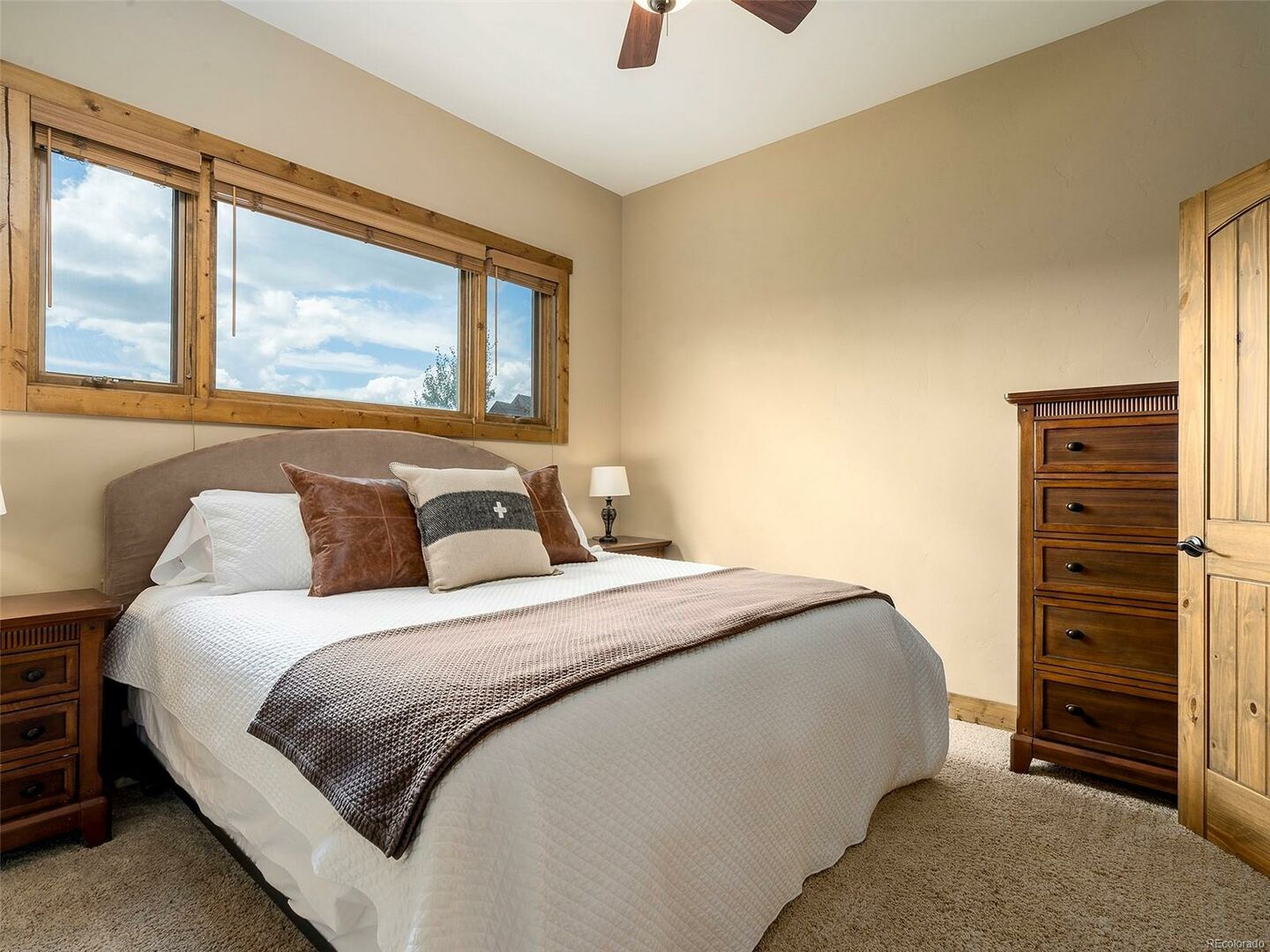 Bedroom with Large Bed, Window, Nightstands, and Dresser.