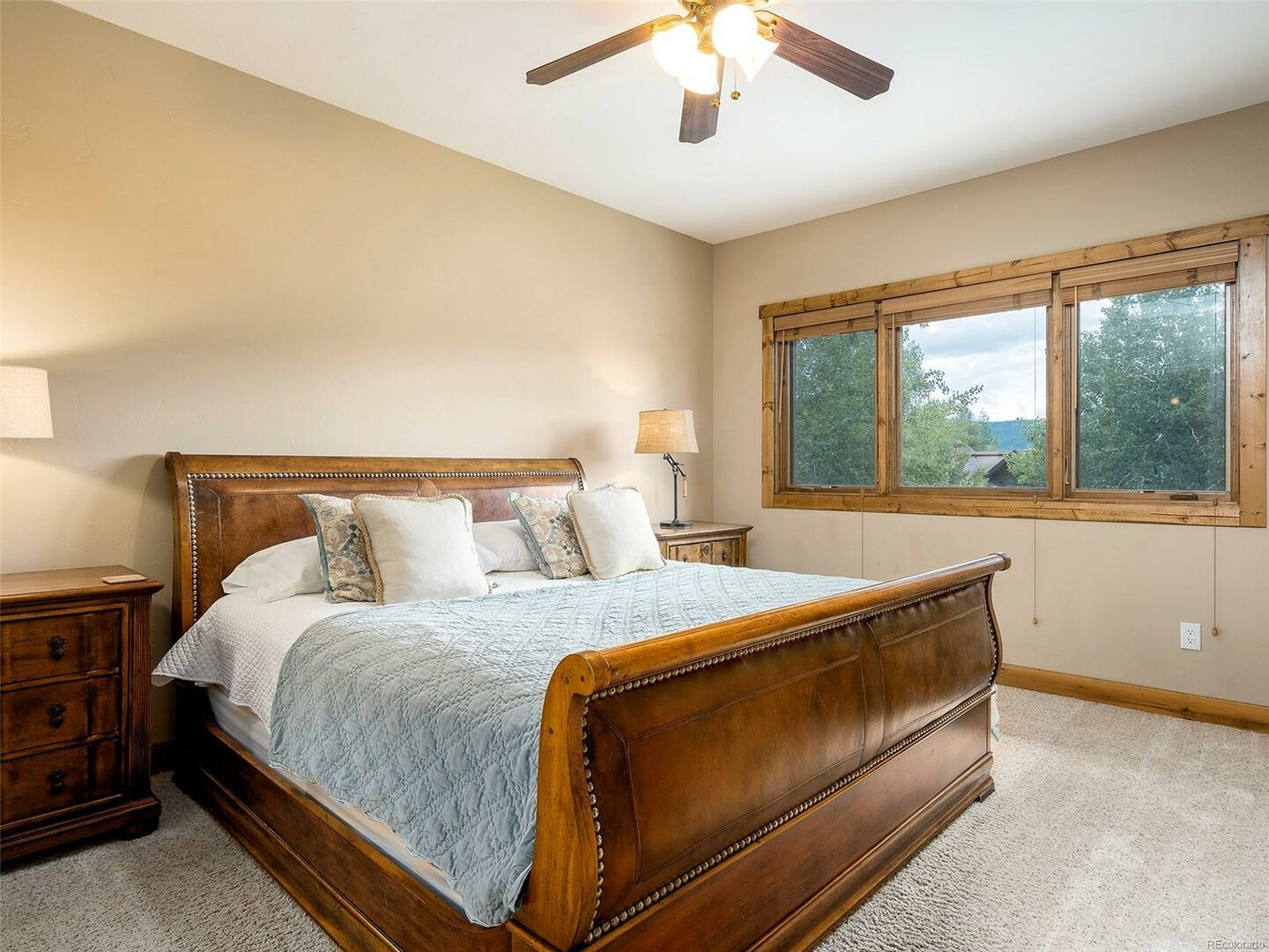 Large Bed, Nightstands, Lamps, and Window.