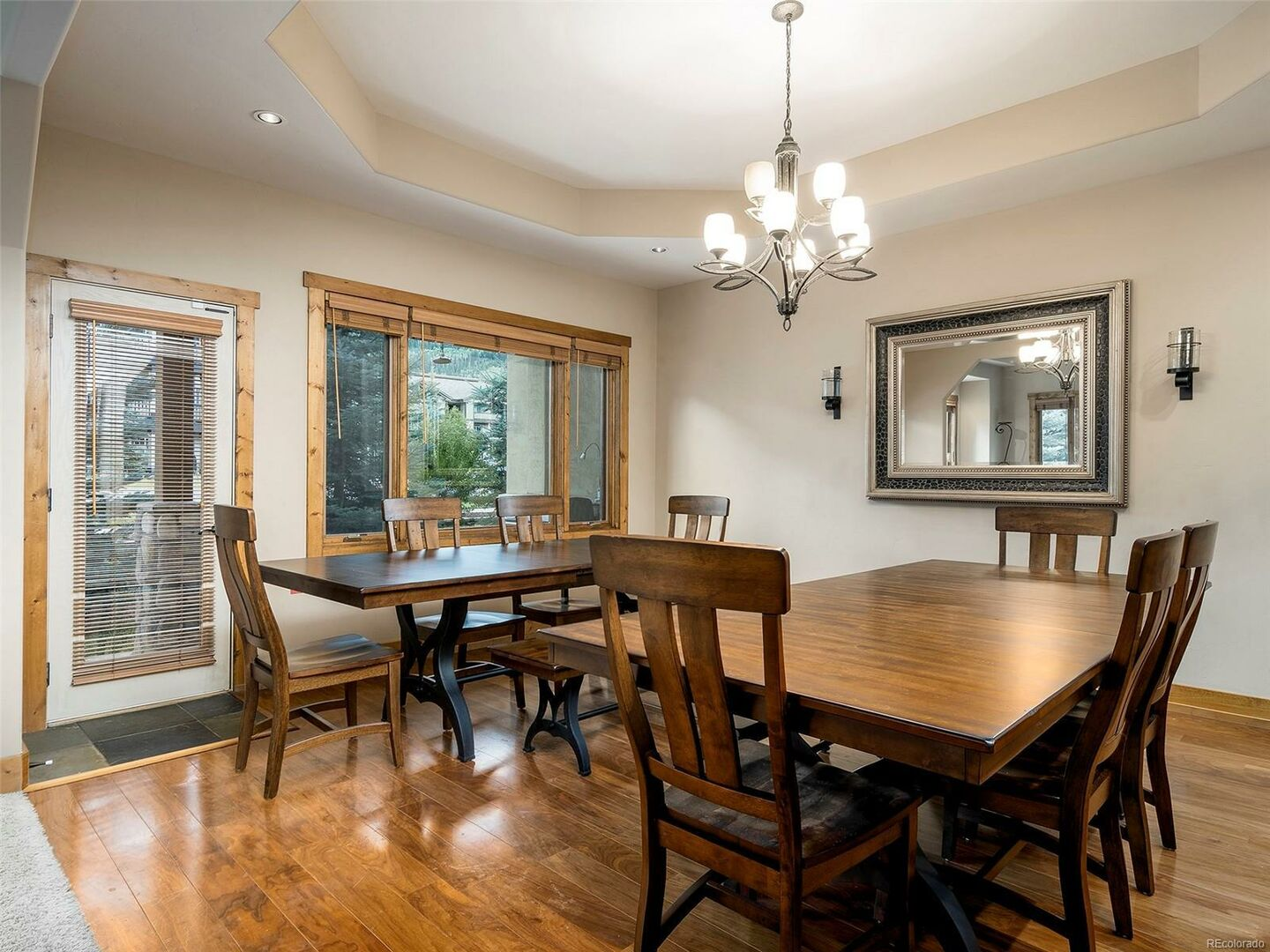 Window Door, Two Dining Tables, Chairs, Mirror, and Ceiling Lamp.