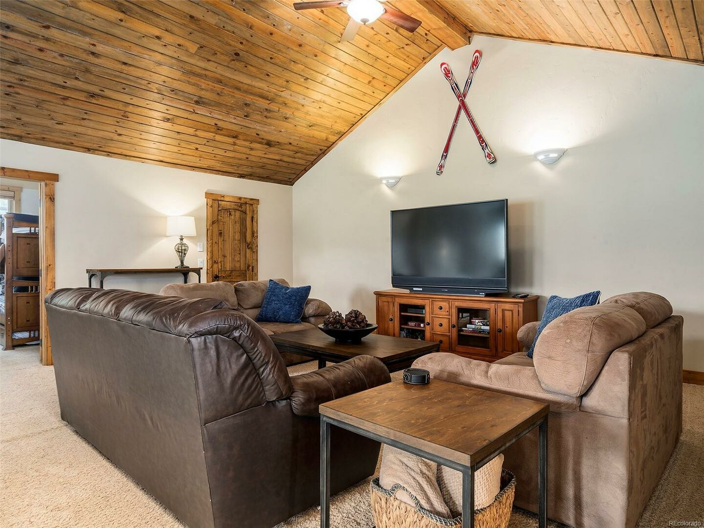 Living Area with TV, Sofas, Side Table, and Buffet Console.