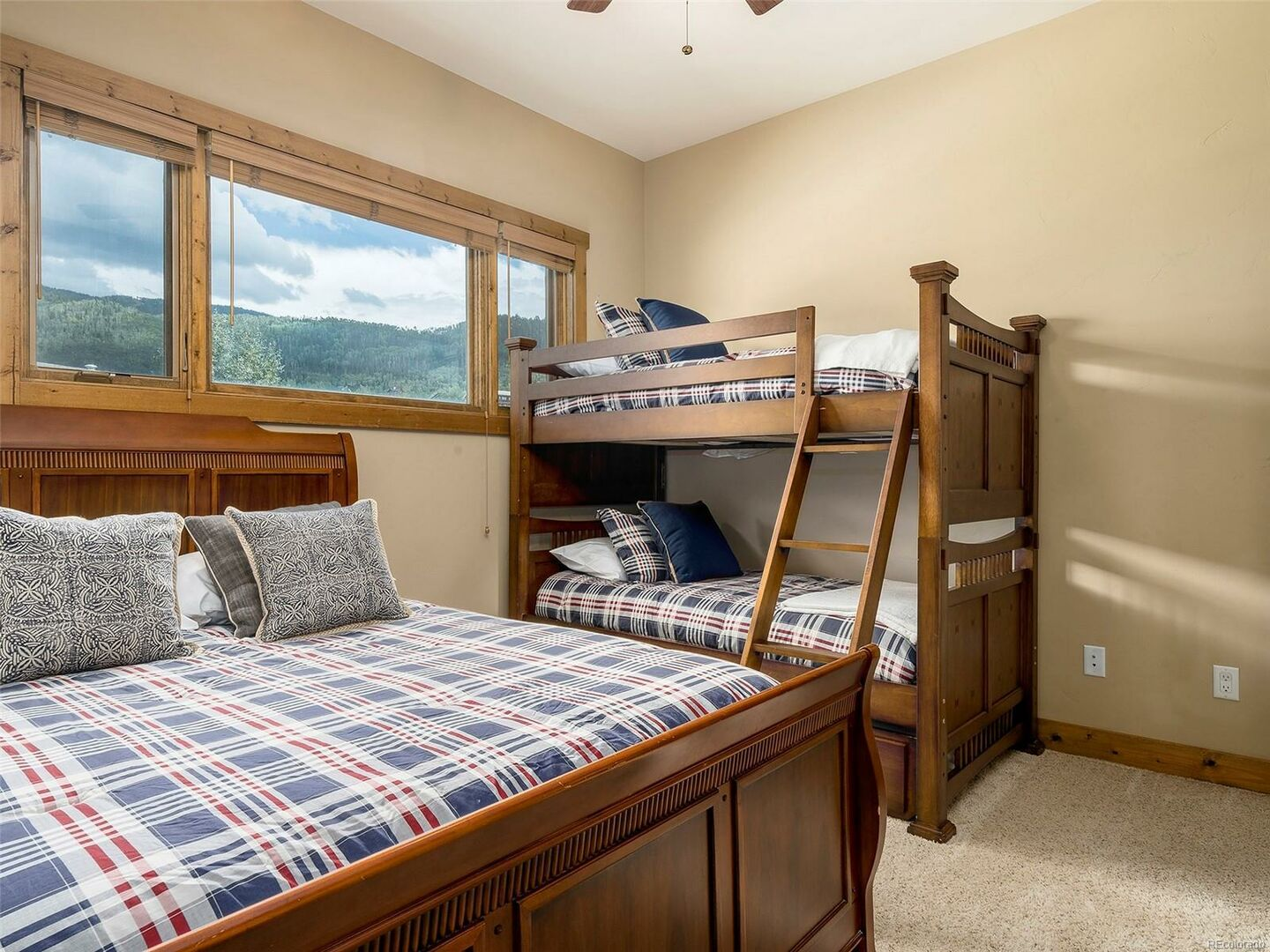 Bedroom with Bunk Bed, Large Bed, and Window.