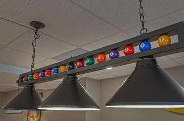 Pool-Themed Overhead Lamp in the Game Room