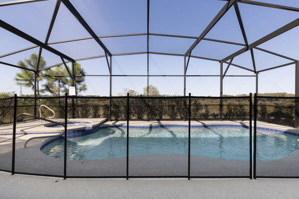 The home features a pool safety fence