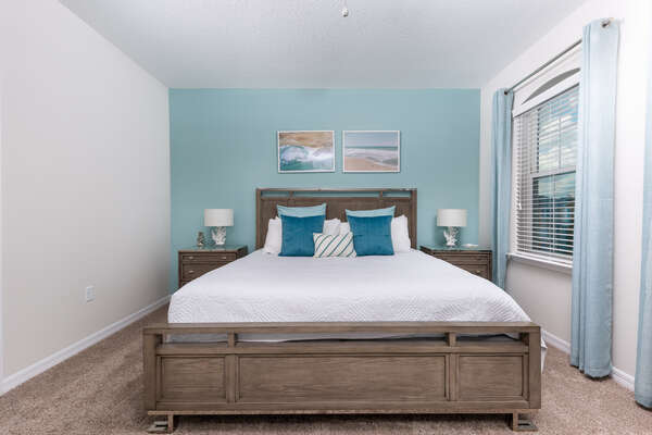Relax after a long day at the theme parks in this comfortable King bedroom