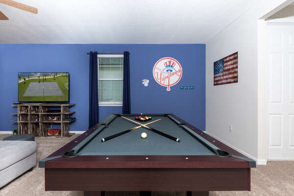 Challenge your family members to a round of pool