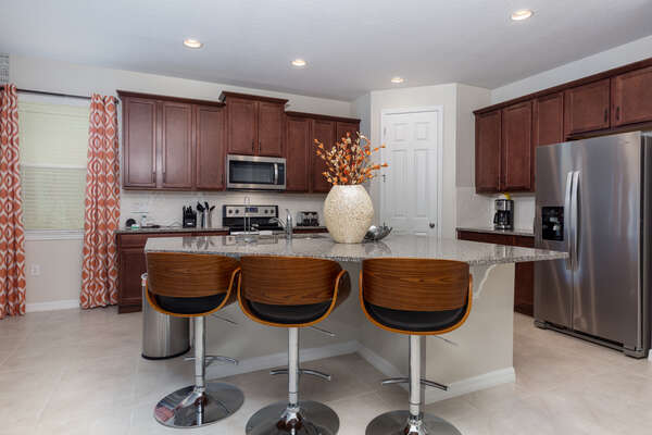 Enjoy a snack at the breakfast bar with seating for 3