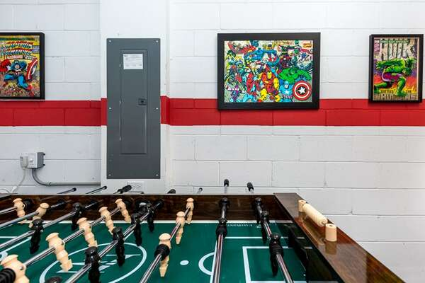 Spend your days playing in this fun superhero game room!