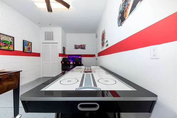The ping pong table converts to an air hockey table as well