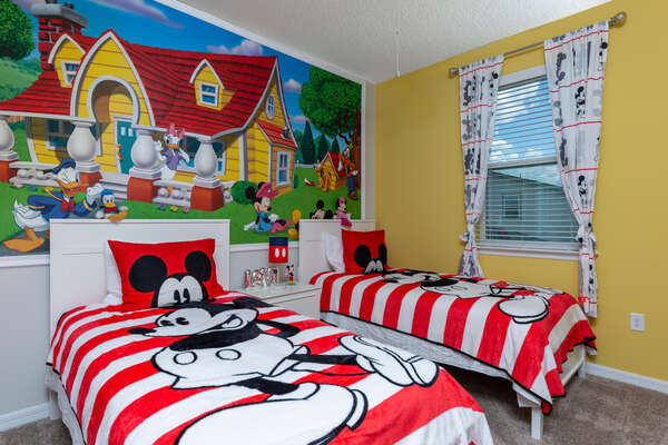 Kids will love this fun bedroom just for them with two twin beds