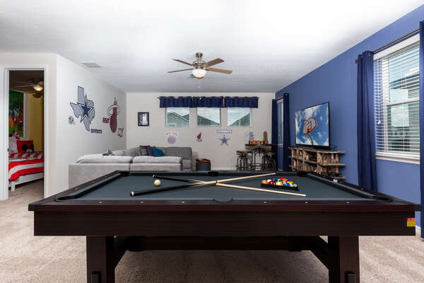 Head upstairs to the sports themed oft game room