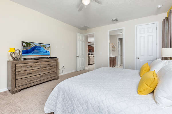 Plush and comfortable bedroom with a TV