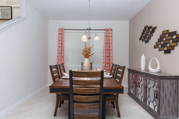 Sit down together to eat at the formal dining area with seating for 6