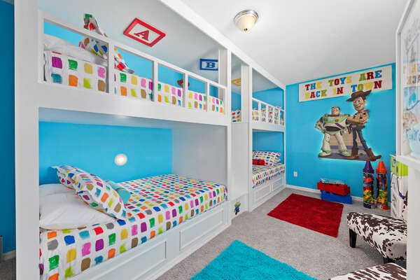 Two Full over Full bunk beds are found in this fun bedroom
