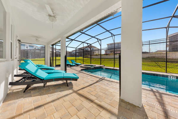 Relax underneath the covered lanai