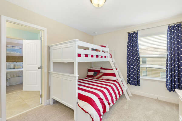 Kids will love this patriotic bedroom with a twin over full bunk bed