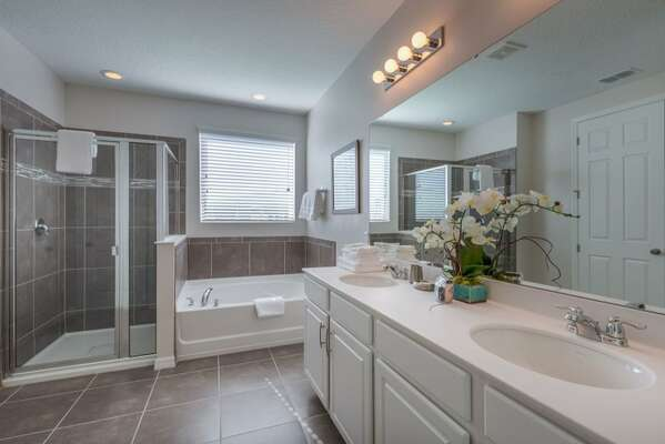 Full bathroom featuring a bathtub, walk-in shower and plenty of space to get ready