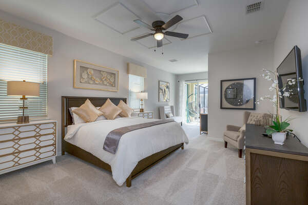 This spacious master suite is on the first floor with a plush king bed