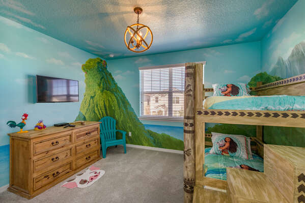 This tropical kids bedroom features a twin over twin bunk bed