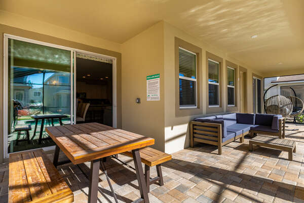 Soak up the Florida sunshine outside at your own private screened-in patio