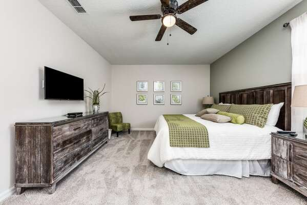 This spacious master suite features a King bed