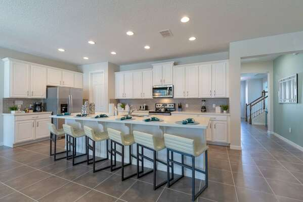Enjoy a snack at the breakfast bar with stools for 6