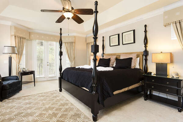 Stylish upstairs master suite with a King bed and balcony access