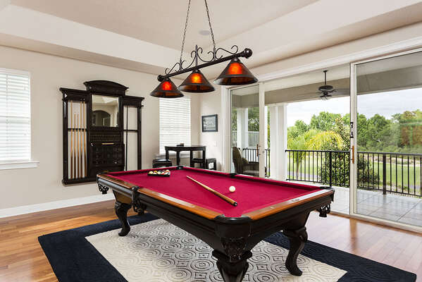 Upstairs lounge features a pool table