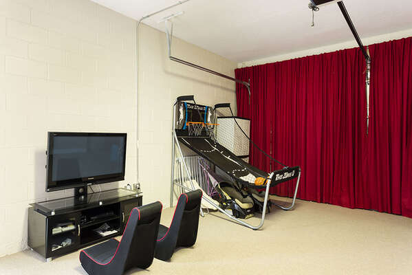 Fun game room with a basketball game, TV and Playstation 3 and Wii gaming systems