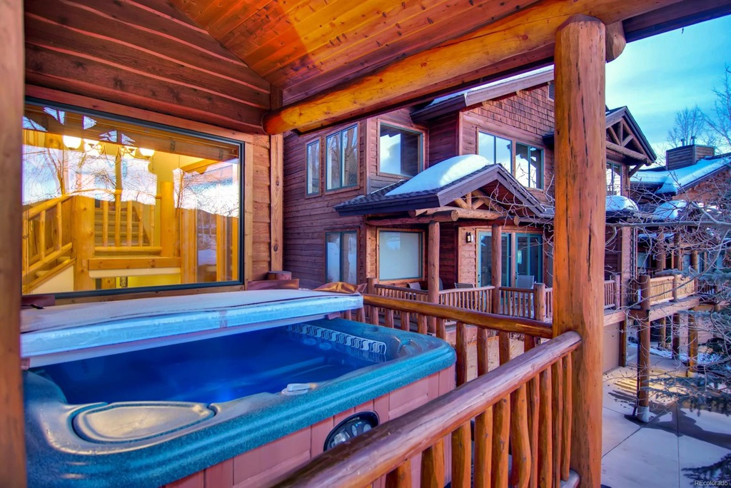 Guests Can Relax in a Private Hot Tub on Deck.