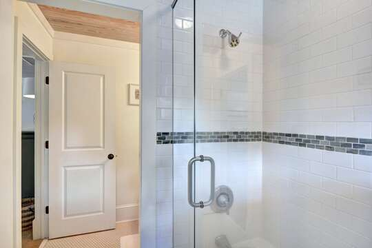 An angled photo of the large walk-in shower in one of this rentals bathrooms.