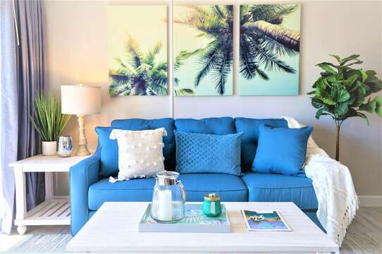 Relax in this coastal casual beach condo - living room walks out onto patio and has a 65