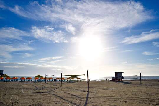 Volleyball courts near the Cocoa Beach Pier (2 minutes form the complex)