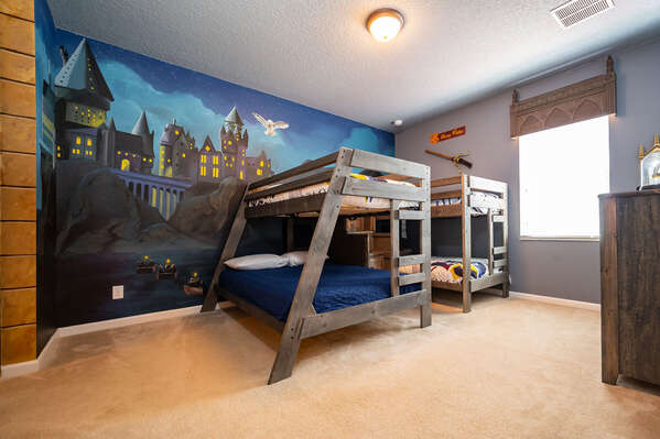 Bedroom 5 is a wizard themed room with dual bunkbeds