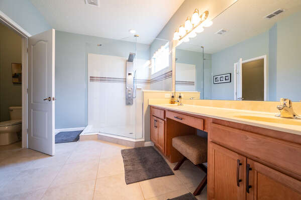 master bathroom with stand up shower and dual sink vanity