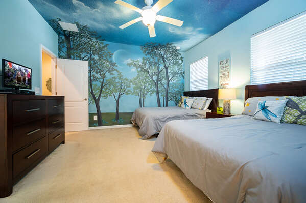 bedroom 6 has a serene forest theme with 2 full size beds